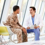 a doctor counseling a soldier at a mental health clinic