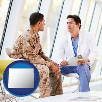 wyoming a doctor counseling a soldier at a mental health clinic